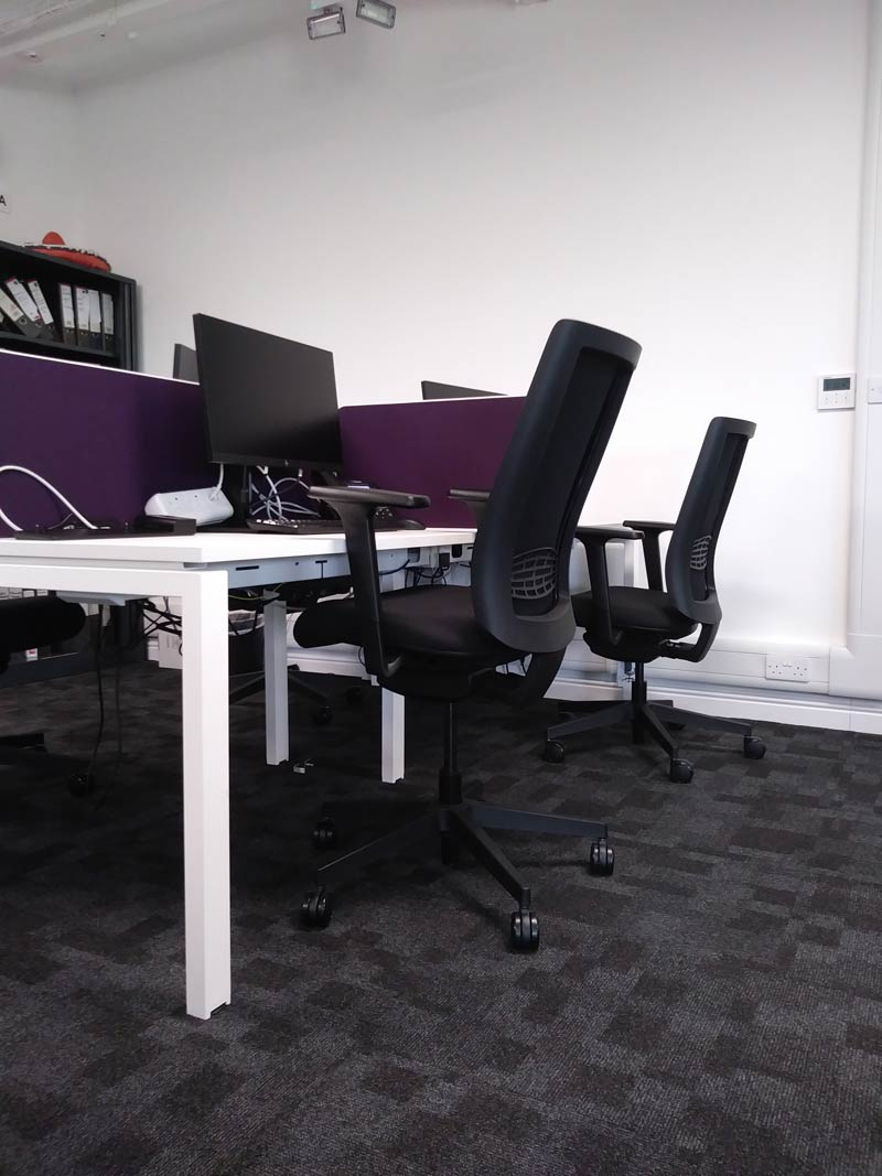 Communal office area with desks and seating after work space fit out